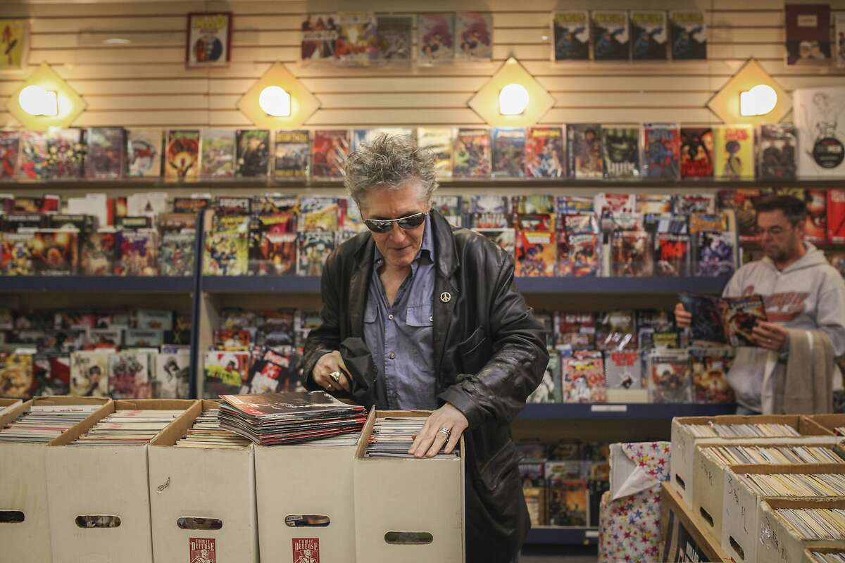 Greg Benteo looks for comics in the 3 for $1 comic box at Jeffrey's Toys on Market street in San Francisco on March 27th 2015. Jeffrey's Toys recently lost its lease and is looking for a new location.
