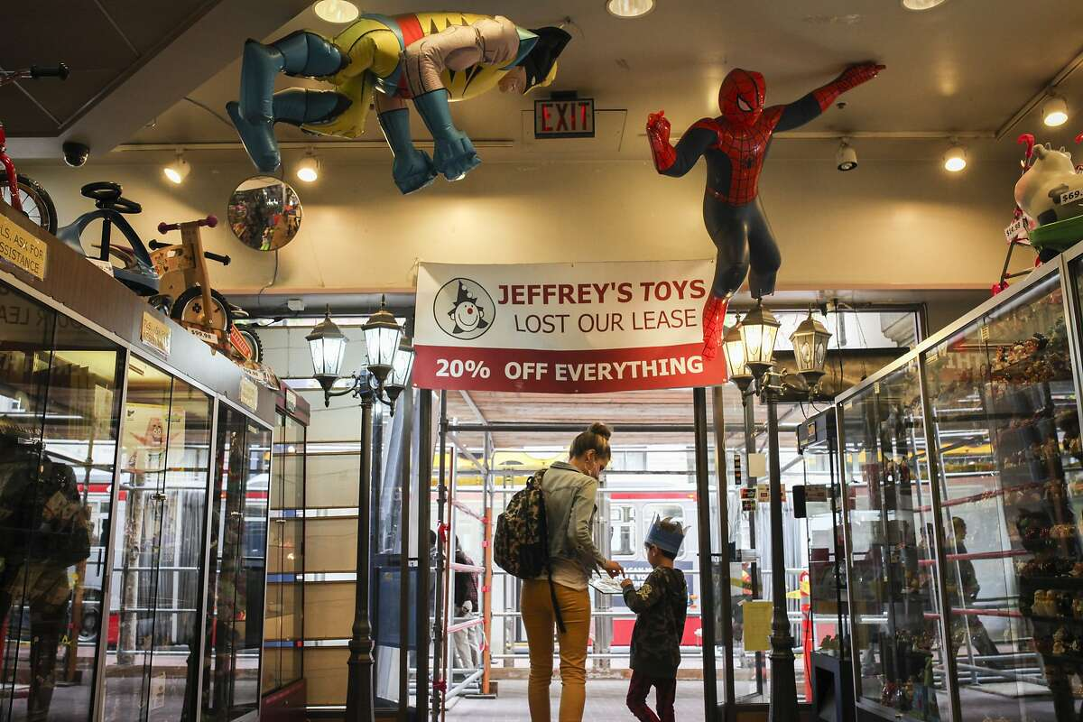 Ethan Marshall and Kylee Fournier leave Jeffrey's Toys on Market street in San Francisco after a visit on March 27th 2015.