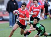 Greenwich's Bryce Stanback scores a try during a match against Stamford Academy at Greenwich High School on Friday, March 27, 2015.
