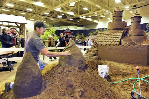 """Phil Singer of Amsterdam, """"The Sand Man""""  builds a giant sand castle at the Capital District Garden & Flower Show at HVCC Friday March 27, 2015 in Troy, NY.  (John Carl D'Annibale / Times Union) Photo: John Carl D'Annibale / 00031205A"""