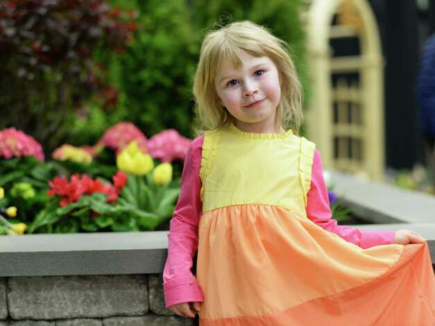 Gabriella Boch, 4, of Schodack poses in front of a floral display the Capital District Garden & Flower Show at HVCC Friday March 27, 2015 in Troy, NY.  (John Carl D'Annibale / Times Union) Photo: John Carl D'Annibale / 00031205A
