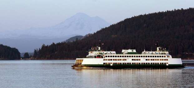 A Washington state ferry passes through a channel in the San Juan islands. People on San Juan island lost Internet and phone service for 10 days there in 2013. Photo: Elaine Thompson /Associated Press / AP