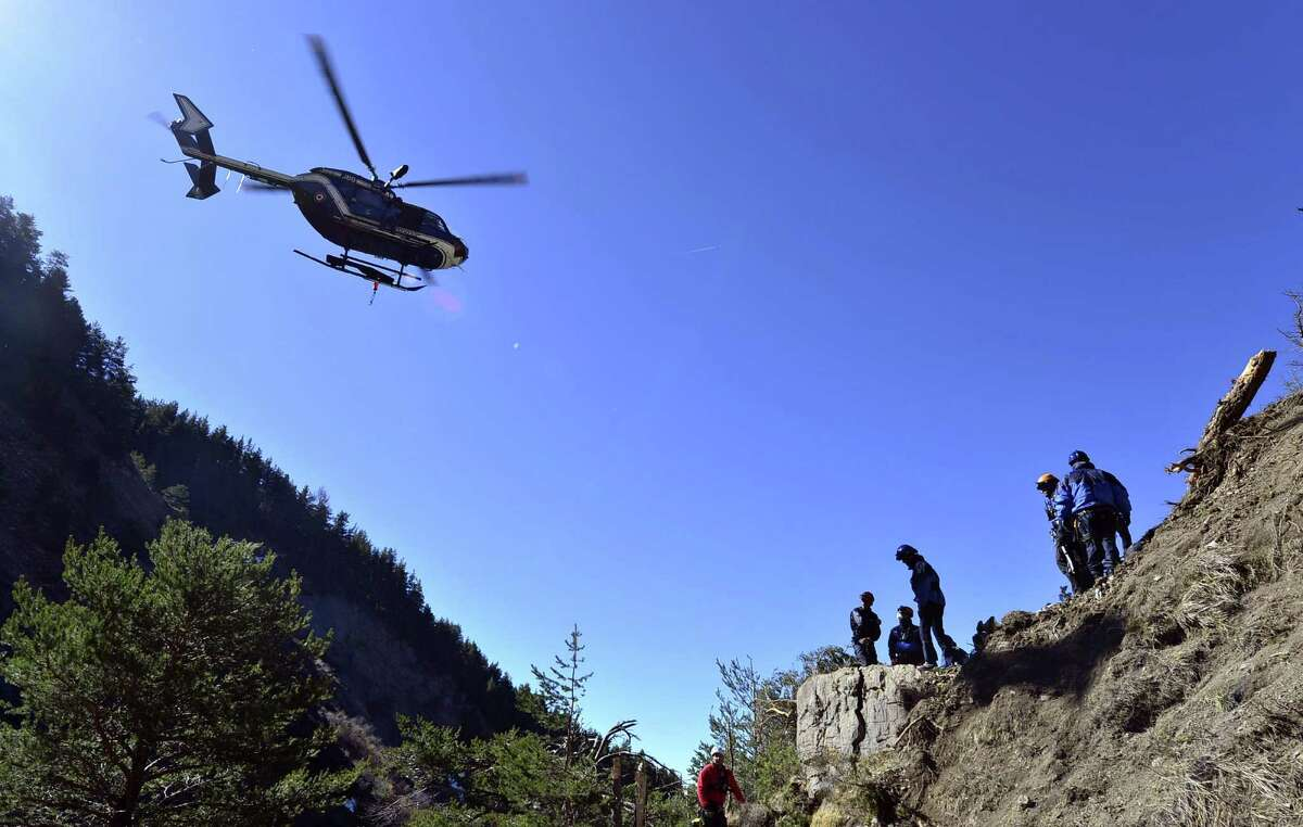An EC 145 Eurocopter hovers over members of the Gendarmerie High-Mountain Rescue Group on Thursday.