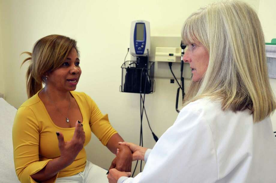 Volunteer nurse practitioner Anne Rutherford examines a patient at the Weisman AmeriCares Free Clinic of Bridgeport. Photo by Donna Porstner/AmeriCares Photo: Contributed Photo / Stamford Advocate  contributed