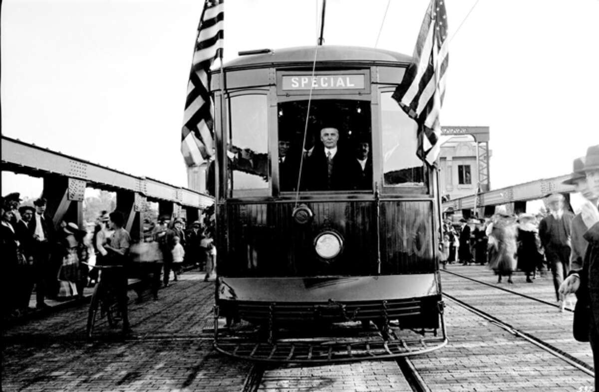 Seattle Mayor Ole Hanson operating the first municipal street car to cross University Bridge during its dedication on July 1, 1919.