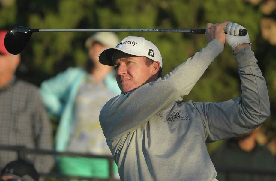 Jimmy Walker watches his drive fly from the 15th during second-round action of the Valero Texas Open at TPC San Antonio on Friday, March 27, 2015. Walker shot a 5 under par on Friday. Photo: Billy Calzada, Staff / San Antonio Express-News / San Antonio Express-News
