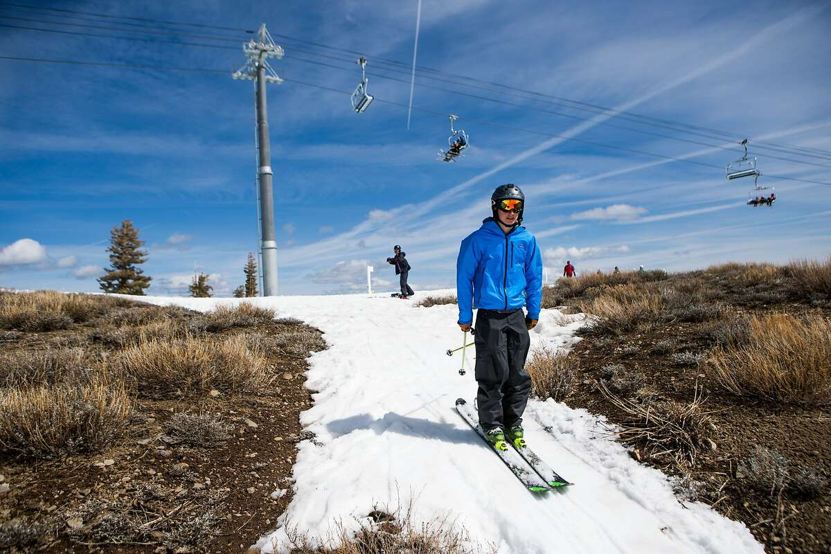 OLYMPIC VALLEY, CA- MARCH 21: A skiers threads his way through patches of dry ground at Squaw Valley Ski Resort, March 21, 2015 in Olympic Valley, California. Many Tahoe-area ski resorts have closed due to low snowfall as California's historic drought continues. (Photo by Max Whittaker/Getty Images)