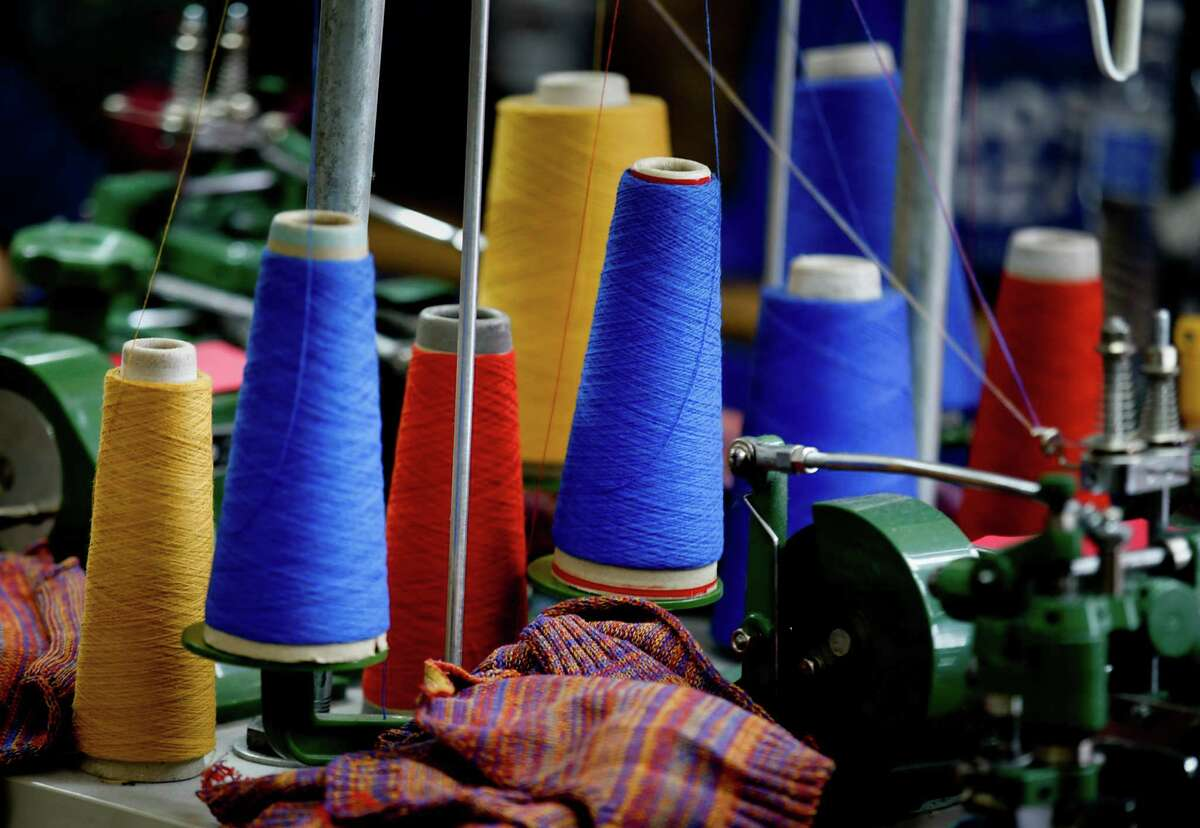 Spools of brightly colored yarns and thread are used to stitch some of the knitwear together at the American Apparel factory on Feb. 27, 2015 in Los Angeles, where new CEO Paula Schneider is now guiding the company. (Mark Boster/Los Angeles Times/TNS)