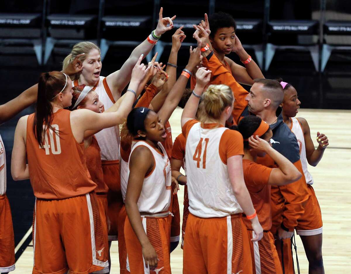 Texas players gather during practice for a women's college basketball regional semifinal game in the NCAA Tournament on Friday, March 27, 2015, in Albany, N.Y. Texas plays Connecticut on Saturday. (AP Photo/Mike Groll) ORG XMIT: NYMG119