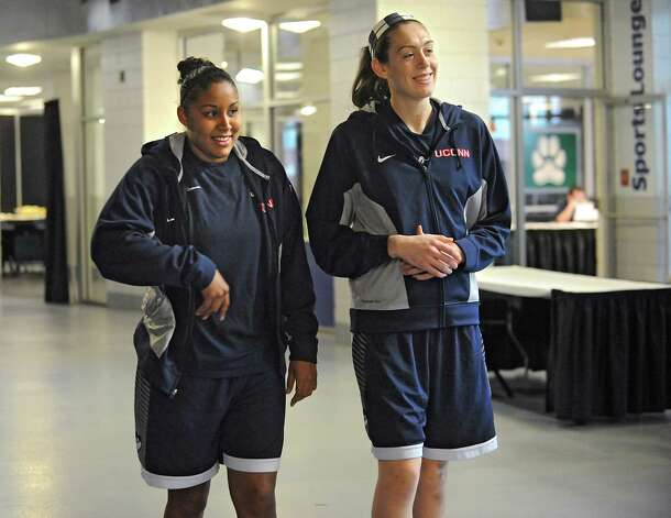 UConn players Kaleena Mosqueda-Lewis, left, and Breanna Stewart walk back to the locker room after answering questions from reporters at a press conference at the Times Union Center Friday, March 27, 2015 in Albany, N.Y. UConn takes on Texas in the NCAA women's tournament tomorrow.  (Lori Van Buren / Times Union) Photo: Lori Van Buren / 00031196A