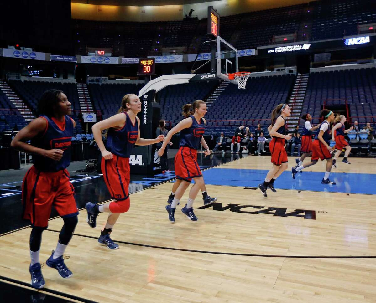 Dayton players warm up during practice for a women's college basketball regional semifinal game in the NCAA Tournament on Friday, March 27, 2015, in Albany, N.Y. Dayton plays Louisville on Saturday. (AP Photo/Mike Groll) ORG XMIT: NYMG139