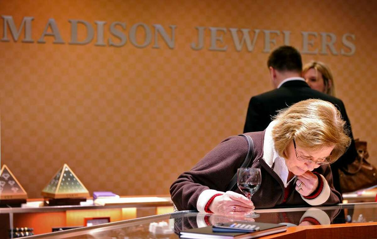Barbara Fry, of Easton, browses the selection at Madison Jewelers during