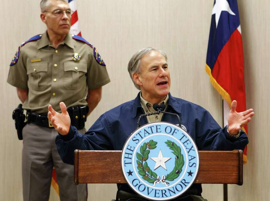 Gov. Greg Abbott discusses his border security plan during a news conference as Texas Department of Public Safety Director Steve McCraw stands behind him in Weslaco.  Photo: Nathan Lambrecht /Associated Press / The Monitor