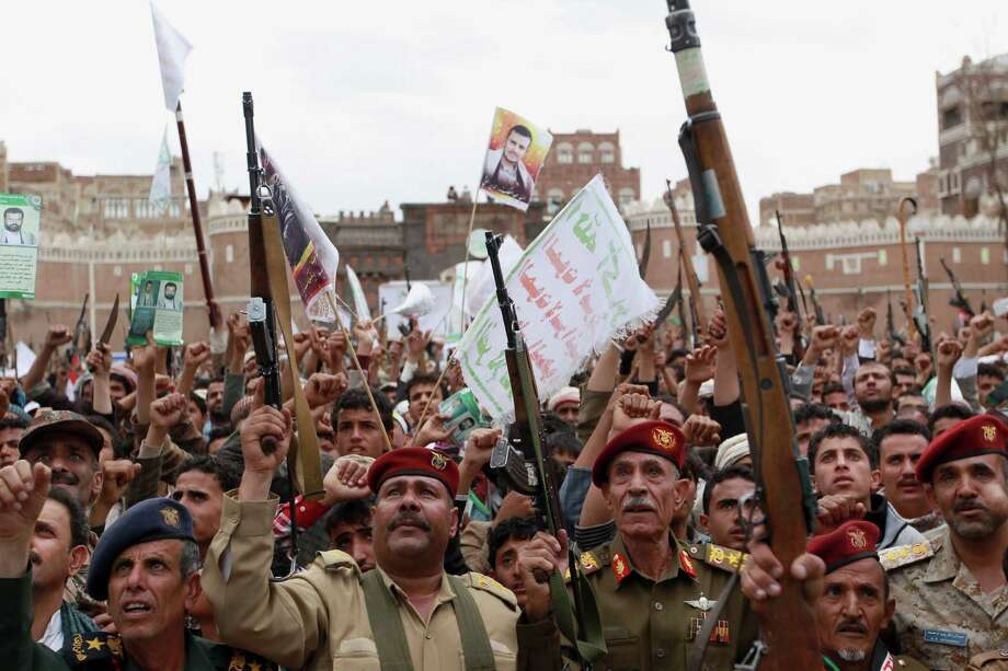 Shiite rebels, known as Houthis, hold up their weapons to protest against Saudi-led airstrikes, during a rally in Sanaa, Yemen, Thursday, March 26, 2015. Saudi Arabia bombed key military installations in Yemen on Thursday, leading a regional coalition in a campaign against Shiite rebels who have taken over much of the country and drove out the president. (AP Photo/Hani Mohammed) ORG XMIT: AHM115 Photo: Hani Mohammed / AP