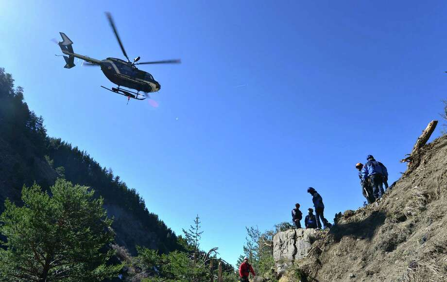 In this undated photo provided by the French Interior Ministry, French emergency rescue services work at the site of the Germanwings jet that crashed on Tuesday, March 24, 2015 near Seyne-les-Alpes, France. The co-pilot of the Germanwings jet barricaded himself in the cockpit and intentionally rammed the plane full speed into the French Alps, ignoring the captain's frantic pounding on the door and the screams of terror from passengers, a prosecutor said Thursday. (AP Photo/French Interior Ministry, Francis Pellier) ORG XMIT: XLON107 Photo: Francis Pellier / French Interior Ministry