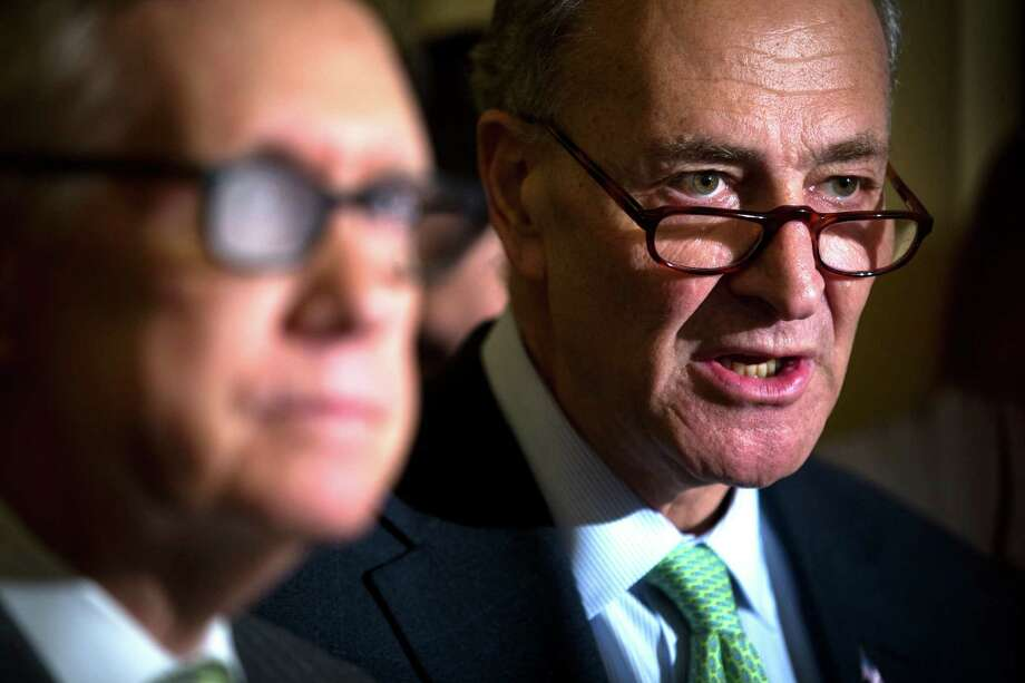 Sen. Chuck Schumer (D-N.Y.), right, and Senate Minority Leader Harry Reid (D-Nev.) speak to reporters following a policy luncheon on Capitol Hill in Washington, March 17, 2015. (Doug Mills/The New York Times) ORG XMIT: XNYT77 Photo: DOUG MILLS / NYTNS