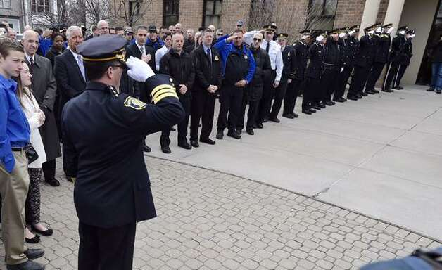 Retiring Albany Police Chief Steven Krokoff gives a final salute on Friday, March 27, 2015 at Police Headquarters, Henry Johnson Blvd., Albany. (Skip Dickstein/Times Union)