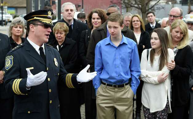 Steve Krokoff, left gives his farewell speech as Chief of Department Friday afternoon March 27, 2015 in Albany, N.Y. to take a position as Chief of a small department in Georgia.  Looking on are son Brett, center, daughter Taylor, second from right and wife Lynn, right.     (Skip Dickstein/Times Union) Photo: SKIP DICKSTEIN / 00031180A