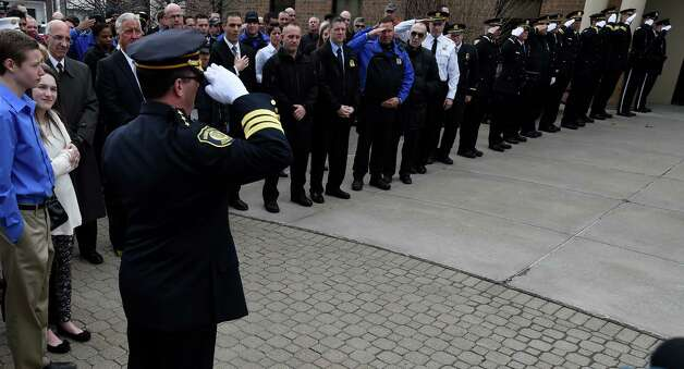 Chief Steve Krokoff salutes his member after giving his farewell speech upon his retirement from the Albany Police Friday afternoon March 27, 2015 in Albany, N.Y. to take a position as Chief of a small department in Georgia.      (Skip Dickstein/Times Union) Photo: SKIP DICKSTEIN / 00031180A