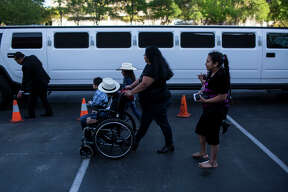 """Rose Sanchez pushes her son Danny Sanchez in a wheelchair towards a limo during the 15th Annual Little Heroes Prom for hundreds of children with cancer across South Central Texas at the Omni Hotel in San Antonio, TX on Friday, March 27, 2015. Danny Sanchez, who was diagnosed with a brain tumor, is attending the prom for the first time. """"I think it is important for kids like Danny to have a good time and feel included,"""" Rose Sanchez, Danny's mother, said. The family, which included Danny's four brothers and sisters, mother and grandparents, got a ride in the limo before going into the prom."""
