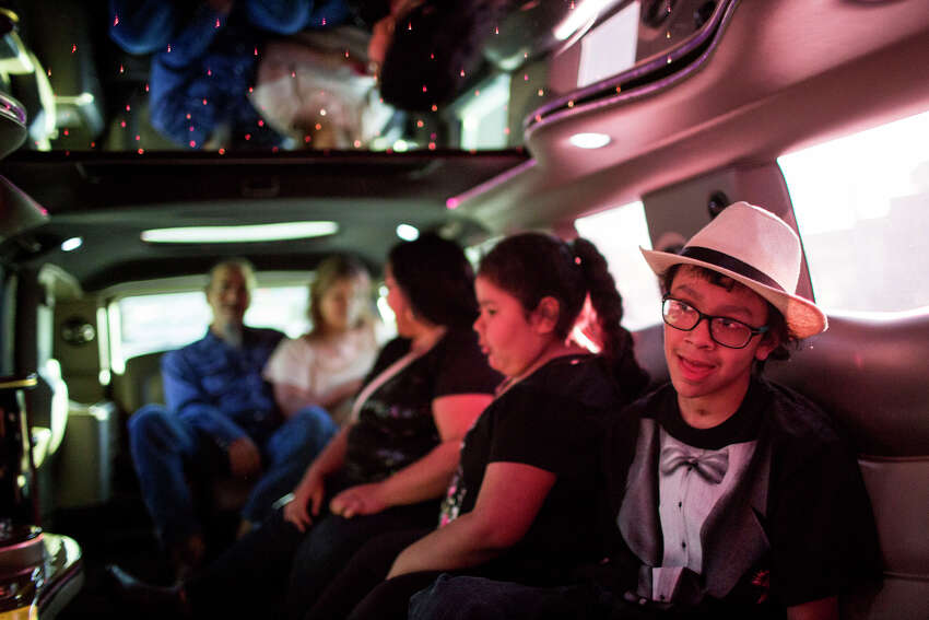 Danny Sanchez laughs and talks with his family during the limo ride he and his family went on before the 15th Annual Little Heroes Prom for hundreds of children with cancer across South Central Texas at the Omni Hotel in San Antonio, TX on Friday, March 27, 2015. Danny Sanchez, who was diagnosed with a brain tumor, is attending the prom for the first time.