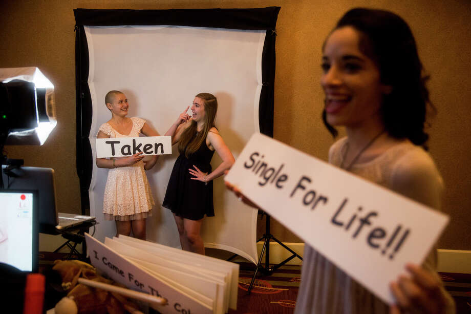 """Joanna Valalis, 17, left, and her friend Arianna Byrom, 16, pose in a flipbook photobooth during the 15th Annual Little Heroes Prom for hundreds of children with cancer across South Central Texas at the Omni Hotel in San Antonio, TX on Friday, March 27, 2015.  """"I just went into remission last weekend, so this is a celebration of that,"""" Valalis said. Photo: Carolyn Van Houten, Staff / San Antonio Express-News / 2015 San Antonio Express-News"""