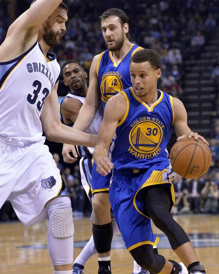 Golden State Warriors guard Stephen Curry (30) drives against Memphis Grizzlies center Marc Gasol (33) in the first half of an NBA basketball game Friday, March 27, 2015, in Memphis, Tenn. (AP Photo/Brandon Dill) Photo: Brandon Dill, Associated Press