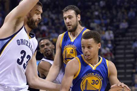 Golden State Warriors guard Stephen Curry (30) drives against Memphis Grizzlies center Marc Gasol (33) in the first half of an NBA basketball game Friday, March 27, 2015, in Memphis, Tenn. (AP Photo/Brandon Dill)