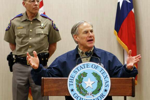 Texas Gov. Greg Abbott, flanked by DPS chief Steve McCraw, discusses the border. GOP contender Scott Walker toured the Weslaco area with Abbott.