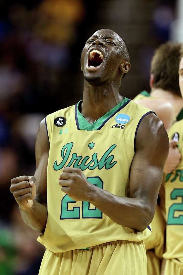 CLEVELAND, OH - MARCH 26: Jerian Grant #22 of the Notre Dame Fighting Irish celebrates after a play in the second half against the Wichita State Shockers during the Midwest Regional semifinal of the 2015 NCAA Men's Basketball Tournament at Quicken Loans Arena on March 26, 2015 in Cleveland, Ohio.  (Photo by Andy Lyons/Getty Images) ORG XMIT: 527066269 Photo: Andy Lyons / 2015 Getty Images