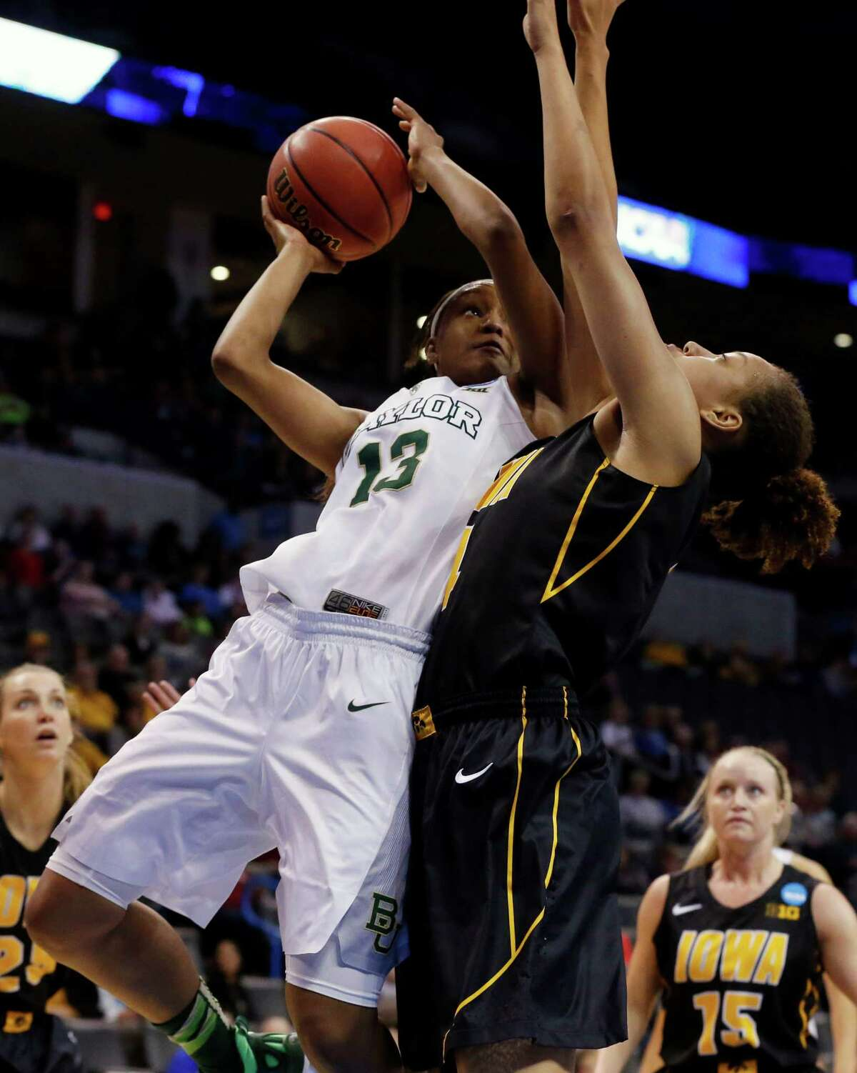 Baylor's Nina Davis (13) goes up for two of her 20 points as Iowa's Chase Coley defends in the first half of the Lady Bears' victory at Oklahoma City.