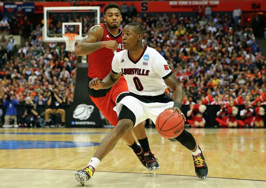 SYRACUSE, NY - MARCH 27:  Terry Rozier #0 of the Louisville Cardinals dribbles against Trevor Lacey #1 of the North Carolina State Wolfpack in the second half of the game during the East Regional Semifinal of the 2015 NCAA Men's Basketball Tournament at the Carrier Dome on March 27, 2015 in Syracuse, New York.  (Photo by Maddie Meyer/Getty Images) ORG XMIT: 527066589 Photo: Maddie Meyer / 2015 Getty Images