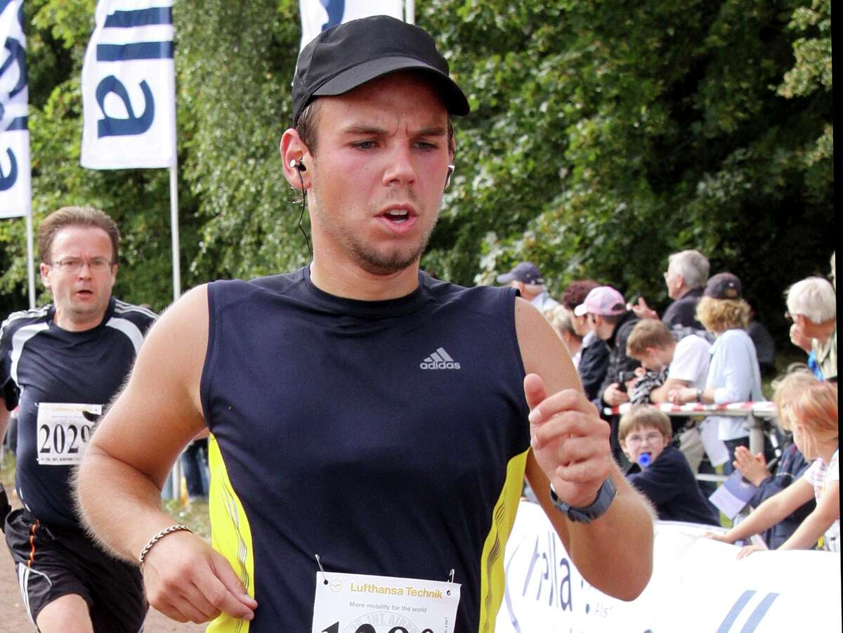 In this Sunday, Sept. 13, 2009 photo Andreas Lubitz competes at the Airportrun in Hamburg, northern Germany. Germanwings co-pilot Andreas Lubitz appears to have hidden evidence of an illness from his employers, including having been excused by a doctor from work the day he crashed a passenger plane into a mountain, prosecutors said Friday, March 27, 2015. The evidence came from the search of Lubitz's homes in two German cities for an explanation of why he crashed the Airbus A320 into the French Alps, killing all 150 people on board. (AP Photo/Michael Mueller) ORG XMIT: FOS203