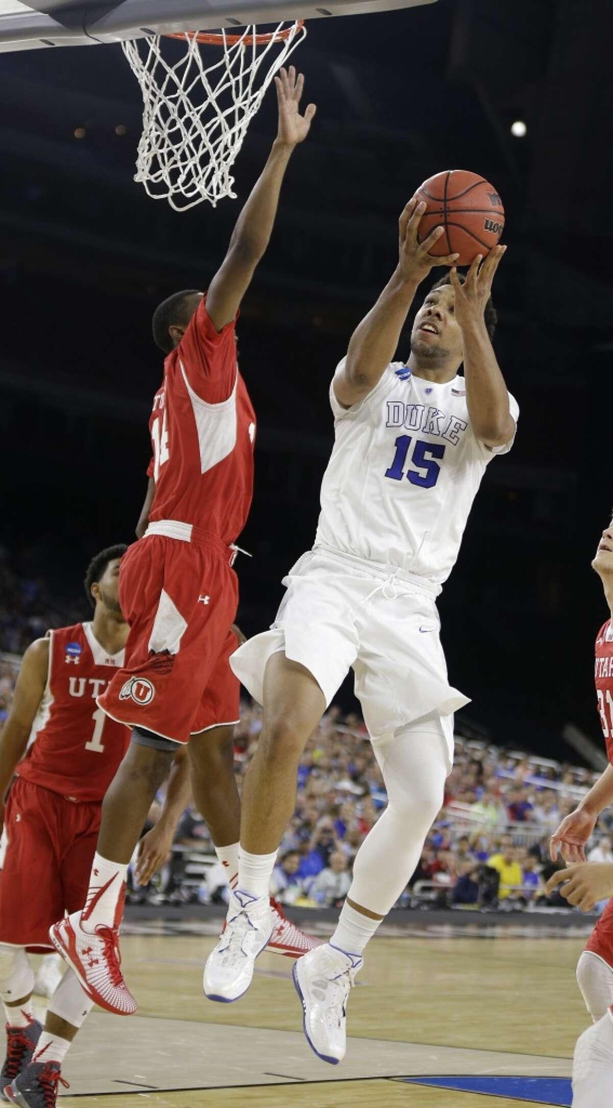 Duke center Jahlil Okafor (15) shoots against Utah guard/forward Dakarai Tucker (14) during the first half of the NCAA South Regional semifinal at NRG Stadium on Friday, March 27, 2015, in Houston. ( Brett Coomer / Houston Chronicle )