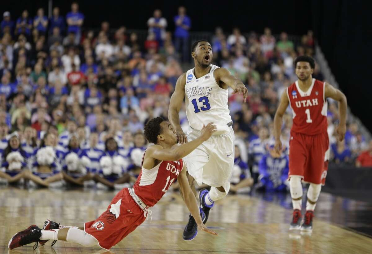 Duke guard Matt Jones (13) and Utah guard Brandon Taylor (11) makes a play for a loose ball during the first half of the NCAA South Regional semifinal at NRG Stadium on Friday, March 27, 2015, in Houston. ( Brett Coomer / Houston Chronicle )