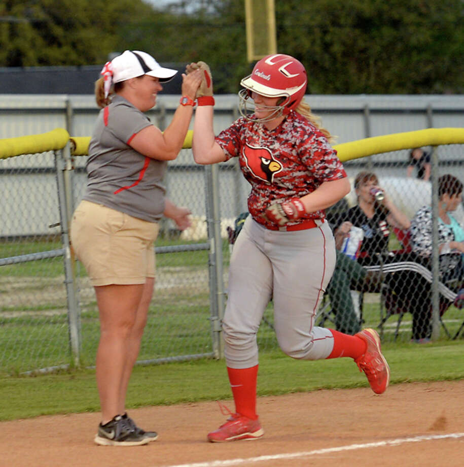 Bridge City's Kasey Frederick is congratulated as she rounds third after hitting a homer and bringing in a second runner as they vie for the top spot in District 24 - 4A Friday night at home against Hardin - Jefferson.  Photo taken Friday, March 27, 2015  Kim Brent/The Enterprise Photo: Kim Brent / Beaumont Enterprise