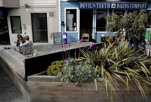 Ann Marie O'Mahony, (Left) and Barbara O'Sullivan enjoy the parklet  in front of Devil's Teeth Baking in the Sunset neighborhood  as seen on Fri. March 27, 2015, in San Francisco, Calif.