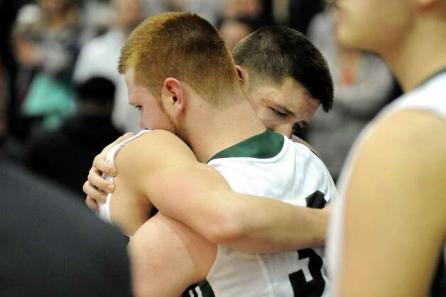 Shen's Matt Alverson, left, and Thomas Huerter embrace after their 44-35 loss to Wings Academy in the Class AA Federation Tournament boys' semifinal on Friday, March 27, 2015, at UAlbany in Albany, N.Y. (Cindy Schultz / Times Union) Photo: Cindy Schultz / 00031189A