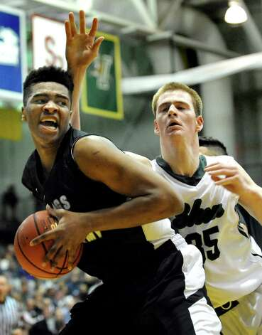 Shen's Brandon Fischer, right, defends as Wings Academy's Jamar Brown wins the rebound in the Class AA Federation Tournament boys' semifinal on Friday, March 27, 2015, at UAlbany in Albany, N.Y. (Cindy Schultz / Times Union) Photo: Cindy Schultz / 00031189A