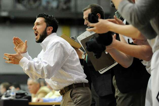 Shen's junior varsity coach Ryan Losanno, left, cheers on the varsity team in the Class AA Federation Tournament boys' semifinal against Wings Academy on Friday, March 27, 2015, at UAlbany in Albany, N.Y. (Cindy Schultz / Times Union) Photo: Cindy Schultz / 00031189A