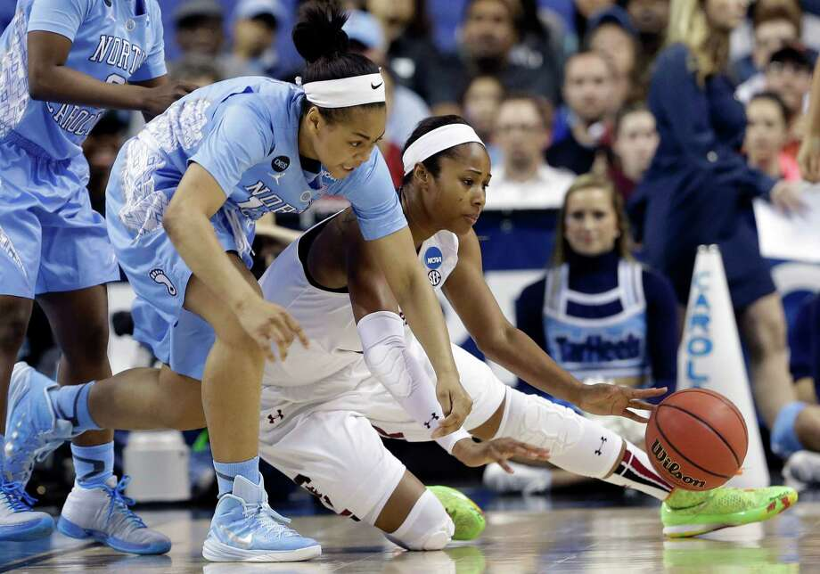 North Carolina's Allisha Gray, left, and South Carolina's Alaina Coates chase a loose ball during the first half of a women's college basketball regional semifinal game in the NCAA Tournament Greensboro, N.C., Friday, March 27, 2015. (AP Photo/Gerry Broome) ORG XMIT: NCGB102 Photo: Gerry Broome / AP