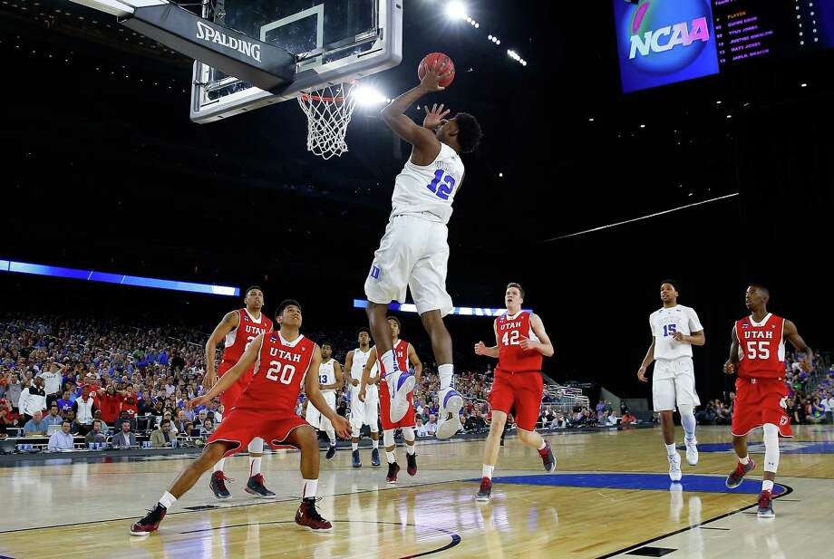 HOUSTON, TX - MARCH 27: Justise Winslow #12 of the Duke Blue Devils takes a shot against the Utah Utes in the first half during a South Regional Semifinal game of the 2015 NCAA Men's Basketball Tournament at NRG Stadium on March 27, 2015 in Houston, Texas.  (Photo by Tom Pennington/Getty Images) ORG XMIT: 527066673 Photo: Tom Pennington / 2015 Getty Images