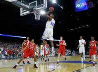 HOUSTON, TX - MARCH 27: Justise Winslow #12 of the Duke Blue Devils takes a shot against the Utah Utes in the first half during a South Regional Semifinal game of the 2015 NCAA Men's Basketball Tournament at NRG Stadium on March 27, 2015 in Houston, Texas.  (Photo by Tom Pennington/Getty Images) ORG XMIT: 527066673