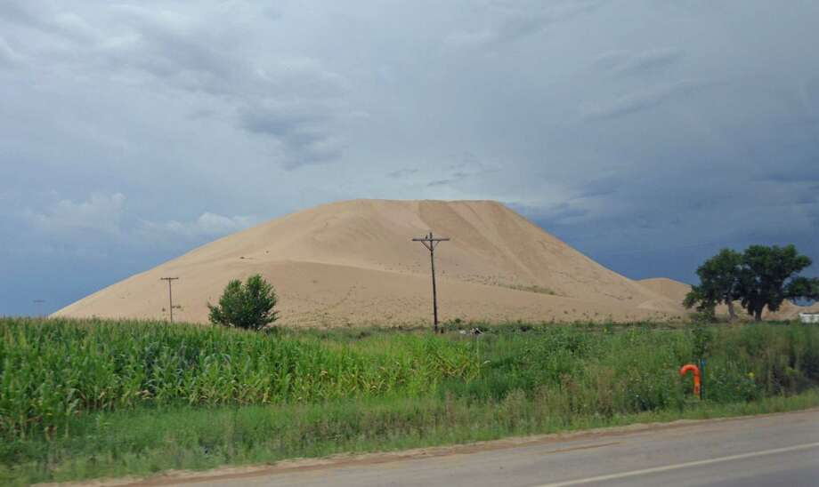 Hydraulic fracturing requires mountains of sand like this in Colorado.  Some say pumping more sand can bring up more oil. Photo: Jennifer A. Dlouhy, HC Staff / Houston Chronicle