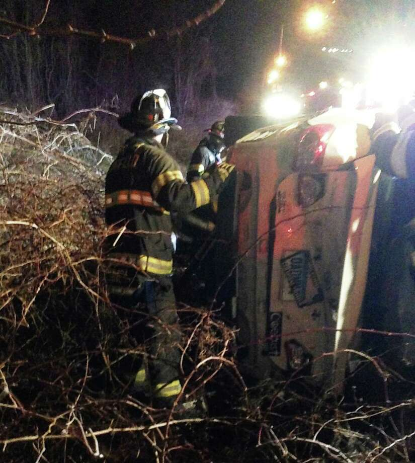 Firefighters work to extricate occupants from one of two vehicles that crashed and rolled over early Saturday on Interstate 95 near the Fairfield-Westport border. Photo: Fairfield Fire Department / Fairfield Citizen
