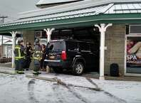 An SUV crashed into a nail salon in Niskayuna on Van Antwerp Road near Union Street Saturday monring, March 28, 2015. (Chris Churchill/Times Union)
