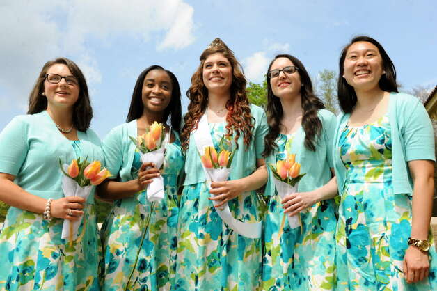 Tulip Queen Caitlin Whelan, 20, of Albany, center, and her court following the coronation at the Tulip Festival on Saturday, May 10, 2014, at Washington Park in Albany, N.Y. From left are Taramari Crisafulli, 21, of Loudonville, Kasmira Wilkins, 18, of Albany, Whelan, Jillian Callanan, 20, of Albany and Meghan Yi, 23, of Albany. (Cindy Schultz / Times Union)