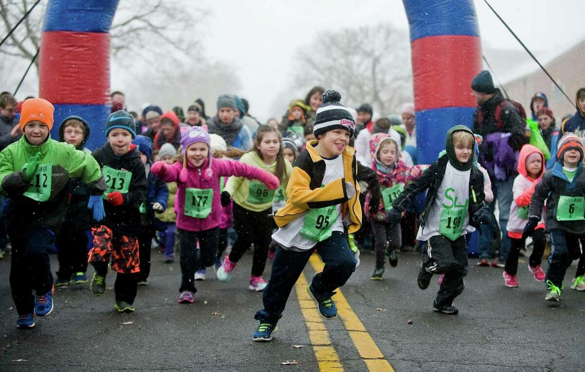 Runners in the age group of five through seven start the kids race at the 3rd annual Sandy Hook 5K race on the Fairfield Hills Campus in Newtown. Saturday, March 28, 2015