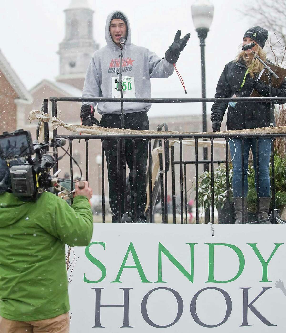 NBC's American Ninja Warrior show competitor Joe Moravsky welcomes the runners in the 3rd annual Sandy Hook 5K race on the Fairfield Hills Campus in Newtown. Saturday, March 28, 2015