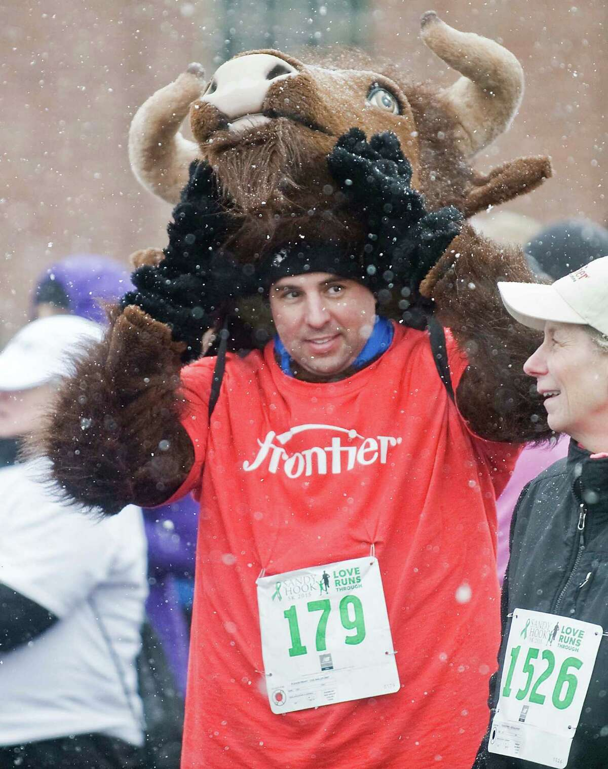 Barry Mustaka readies his buffalo outfit prior to the start of the 3rd annual Sandy Hook 5K race on the Fairfield Hills Campus in Newtown. Saturday, March 28, 2015